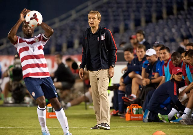 Klinsmann watches DaMarcus Beasley take a throw-in during a friendly with Guatemala at Qualcomm Stadium in San Diego, Calif.