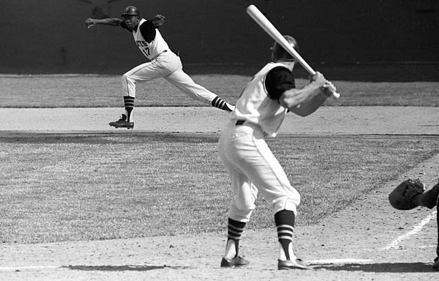 Donn Clendenon of the Pittsburgh Pirates breaks for second base against the New York Mets at Forbes Field.