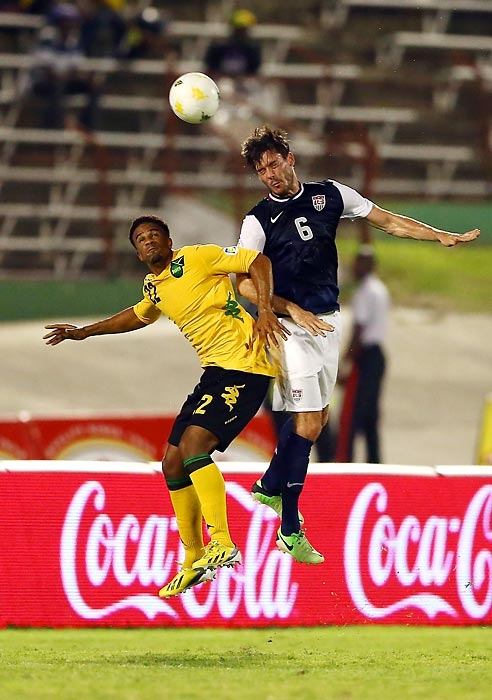 Garath McCleary of Jamaica and Brad Evans of the U.S. elevate for the ball. Evans would score the winning goal in a 2-1 victory on June 7, 2013, in Kingston, Jamaica.