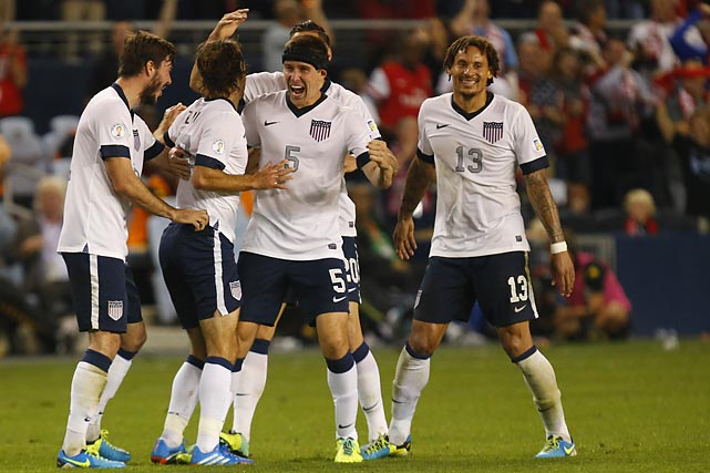 Graham Zusi (second from left) celebrates with U.S. teammates after scoring the first U.S. goal in a 2-0 win over Jamaica on Oct. 11, 2013, in Kansas City, Kan.