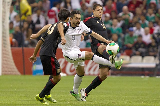 "Mexico's Javier ""Chicharito"" Hernandez (right) tangles with Herculez Gomez of the U.S. on March 26, 2013, in Mexico City. The teams drew 0-0 at Estadio Azteca, marking just the second qualifying point the U.S. had ever earned at the vaunted Mexico City cauldron."