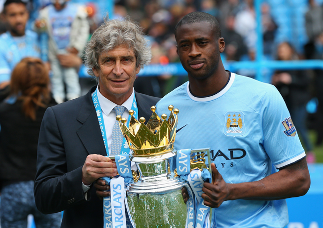 Yaya Toure, right, helped Manchester City manager Manuel Pellegrini capture the Premier League title in his first season at the helm.