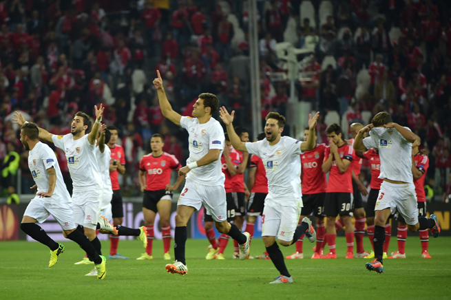 Sevilla players run for joy after Kevin Gameiro's Europa League-clinching penalty secures the trophy for the Spanish side in Turin, Italy.