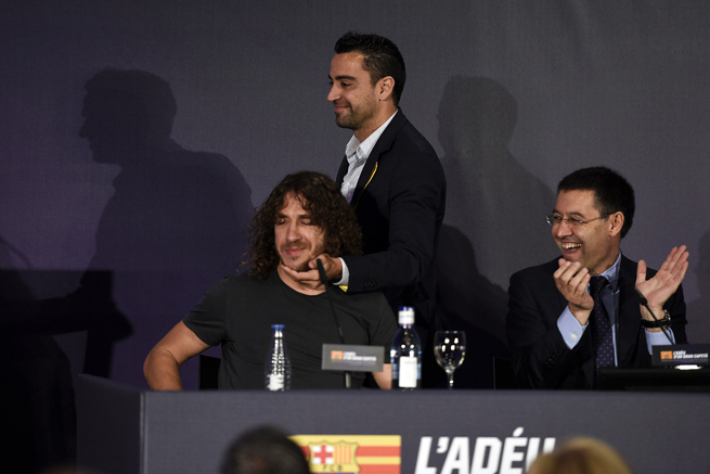 Barcelona and Spain star Xavi gives Carles Puyol some love during the latter's send-off on Thursday, concluding a 15-year career with the club.