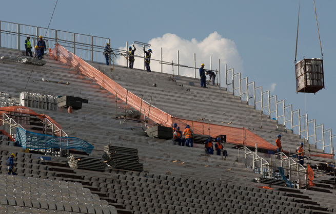 Workers continue to construct Itaquerao Stadium in Sao Paulo, which will host the opening game of the World Cup between Brazil and Croatia.