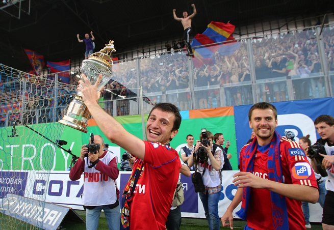 CSKA Moscow's Alan Dzagoev lifts the Russian Premier League trophy after the club claimed the 2013-14 title on Thursday.