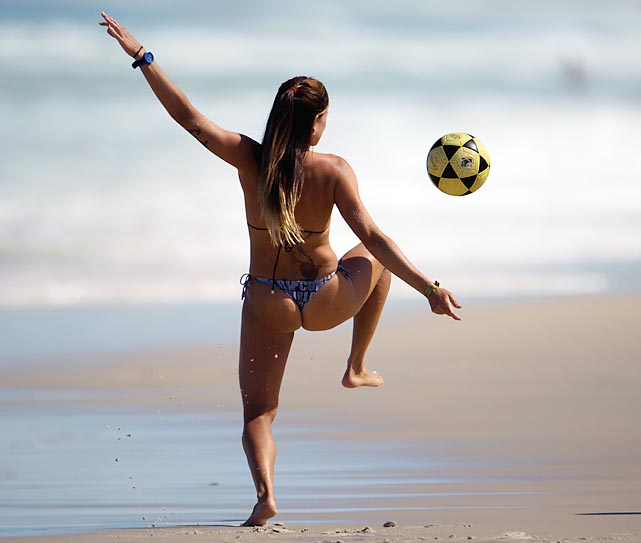 A beach bum was spotted kicking around the event's final at Barra de Tijuca in Rio de Janeiro.