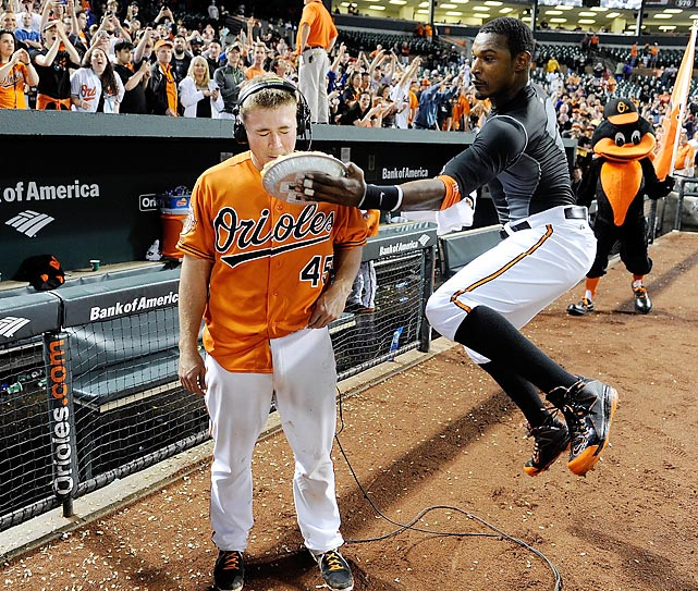 Upper crust: Adam Jones of the Orioles air-mailed desert to Steve Clevenger, who produced the winning RBPIE in the tenth inning vs. the Houston Astros at Oriole Park at Camden Yards in Baltimore.