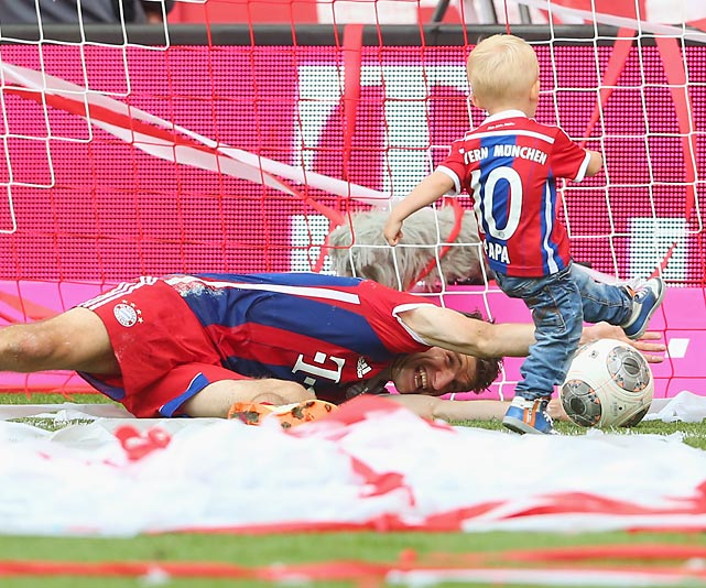 Judging by this dramatic action shot, Bayern Munich has embarked upon a rather dramatic youth movement. One of the club's little shavers put midfielder Thomas Muller to the test before a match against VfB Stuttgart at Allianz Arena in Munich.