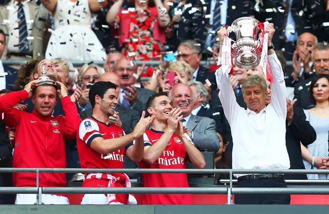 Arsene Wenger lifted a trophy with Arsenal for the first time in nine years on Saturday.