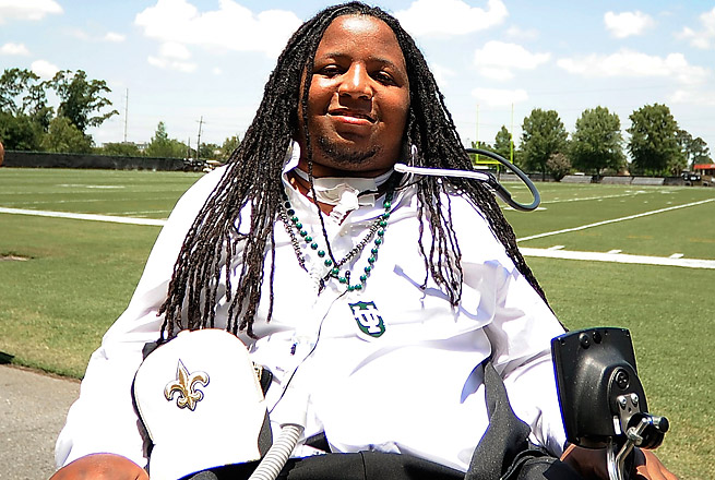 Devon Walker was paralyzed from the neck down while making a tackle at Tulsa in September 2012.