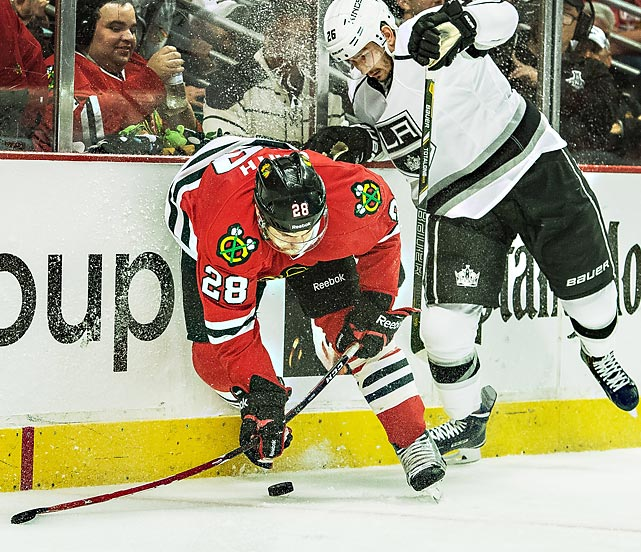 Ben Smith of the Chicago Blackhawks and Slava Voynov of the Los Angeles Kings battle along the boards during Game 1 of the Western Conference Finals.