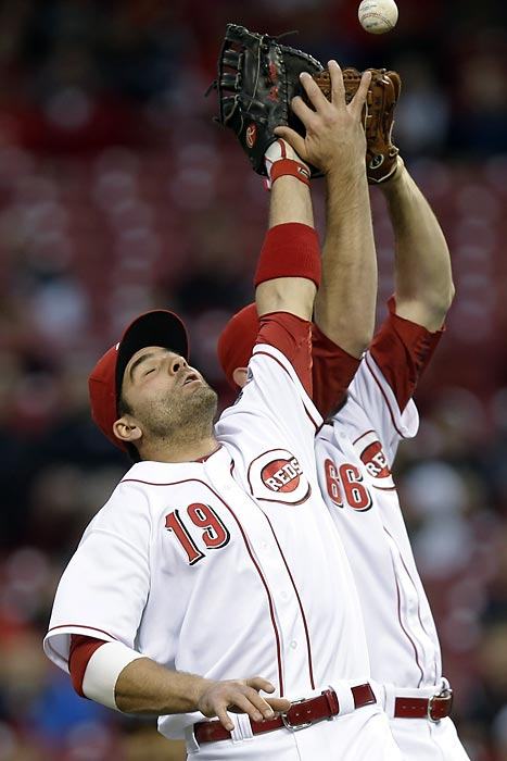 Cincinnati Reds first baseman Joey Votto (19) collides with reliever Logan Ondrusek as both attempt to catch a pop fly by San Diego Padres outfielder Cameron Maybin.