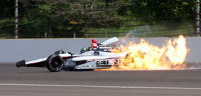 Hot wheels: Kurt Busch's car caught fire after hitting the wall, chilling his chances in the Indy 500.