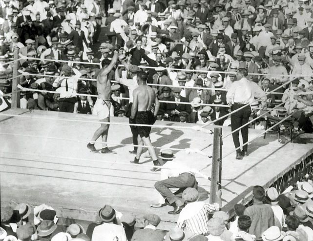 Even today, reaching Shelby, in remote northwest Montana, is a test for travelers. Nearly a century ago it was beyond the reach of all but the most avid boxing fans. Yet city fathers, giddy over the recent discovery of oil on local land, pictured thousands of boxing fans pouring into Shelby to watch heavyweight champion Jack Dempsey, one of the most popular athletes of the era, battle challenger Tommy Gibbons on the Fourth of July. Not quite. Dempsey retained his title in a unanimous 15-round decision but the real loser was Shelby. Fewer than 8,000 fans paid to see the bout in the massive temporary arena. Shelby, which had shelled out hundreds of thousands of dollars in guaranteed money to both fighters, fell hard. Four local banks went bankrupt and Shelby's dreams of becoming a vacation mecca disappeared for good.