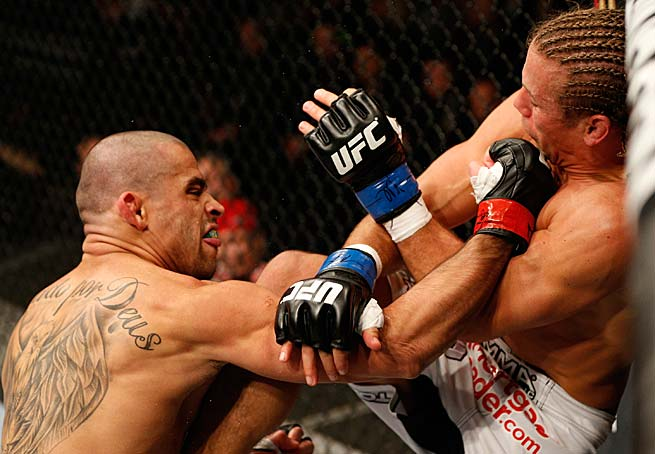 Renan Barao punches Urijah Faber in their bantamweight championship fight at the UFC 169 on Feb. 1 in Newark, N.J.