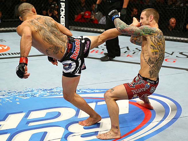 Renan Barao knocks out Eddie Wineland with a kick to the head in their UFC interim bantamweight title fight at the Air Canada Center on Sept. 21, 2013, in Toronto, Ontario, Canada.