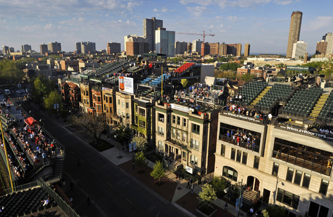 The Cubs want to enact a revamp that would put up video boards that would block rooftop views.