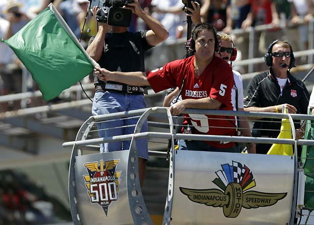 Dallas Mavericks owner Mark Cuban waves the green flag to start the Indianapolis 500.