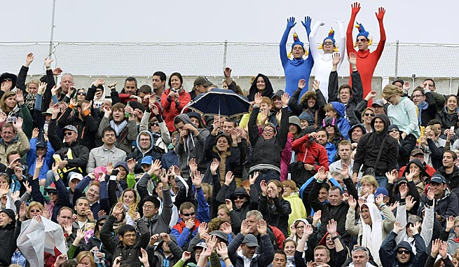The French Open drew big, enthusiastic crowds on Monday despite wet, chilly weather.