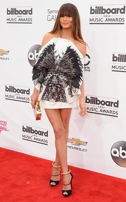 The saucy swimsuit model arrived at the 2014 Billboard Music Awards at the MGM Grand Hotel and Casino in fabulous Las Vegas sporting revolutionary garb apparently fashioned from the remains of a large black bird of some kind.