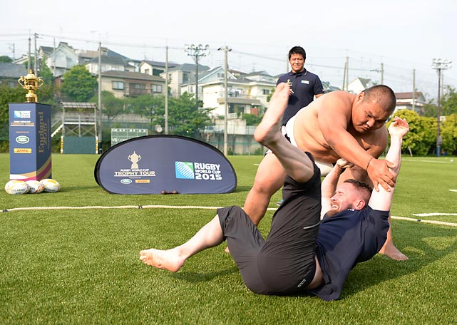 The former Wales international star (bottom) got the worst of one of the more fascinating sports mash-ups of all time: The DHL Rugby vs Sumo Challenge, just one part of the Rugby World Cup Trophy Tour stop in Tokyo.