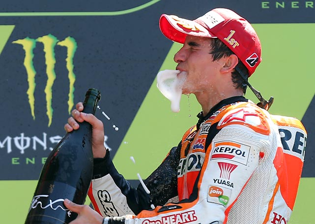 Still emitting exhaust fumes, the Repsol Honda MotoGP rider sought refreshment after winning the World Championship race at the Bugatti race track in Le Mans.