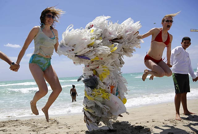 You never know what odd life forms will wash up during this age of widespread pollution and runaway radioactive waste. On Miami Beach, Rachel Bennett of Brooklyn, NY (left) and Tiffany Threadgould of Philadelphia were clearly shocked to find a shopping bag creature that is now being hailed by uninformed scientists as one of the most dramatic examples of marine evolution ever discovered. Turns out that it was just good ol' Steve Vincenti from the next slide.
