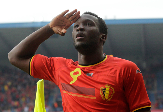 Belgium forward Romelu Lukaku gives a salute after scoring one of his three goals against Luxembourg on Monday.