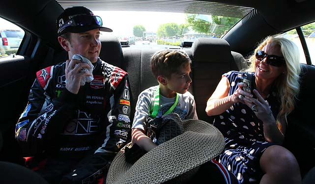 Busch, Driscoll and her son, Houston, being driven to the helicopter that would take him to his flight to Charlotte.