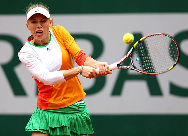 Caroline Wozniacki put up a fight, but couldn't overcome Yanina Wickmayer, losing 7-6 (5), 4-6, 6-2.