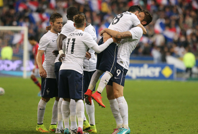 Olivier Giroud, far right, celebrates with Mathieu Valbuena after one of his two goals in France's 4-0 rout of Norway on Tuesday.