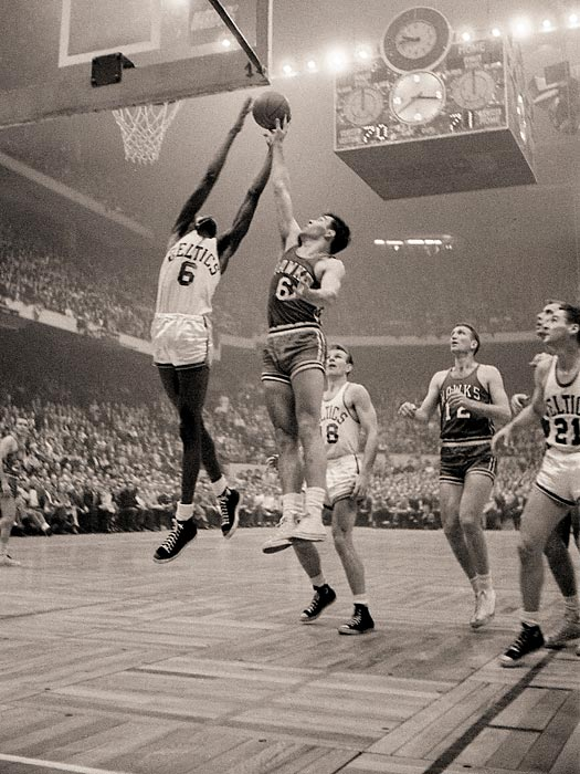 Bill Russell of the Celtics grabs a rebound over Cliff Hagan of the Hawks in Game 5 of the 1957 finals. The Celtics won the game 124-109 and took the series in seven in Russell's rookie year after acquiring his rights in a trade with ... St. Louis.