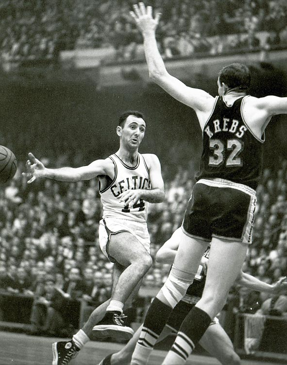 Celtics point guard Bob Cousy (14) throws a no-look pass in Game 7. Later that game, he would famously elude several Lakers and dribble out the clock to deliver Boston the title.