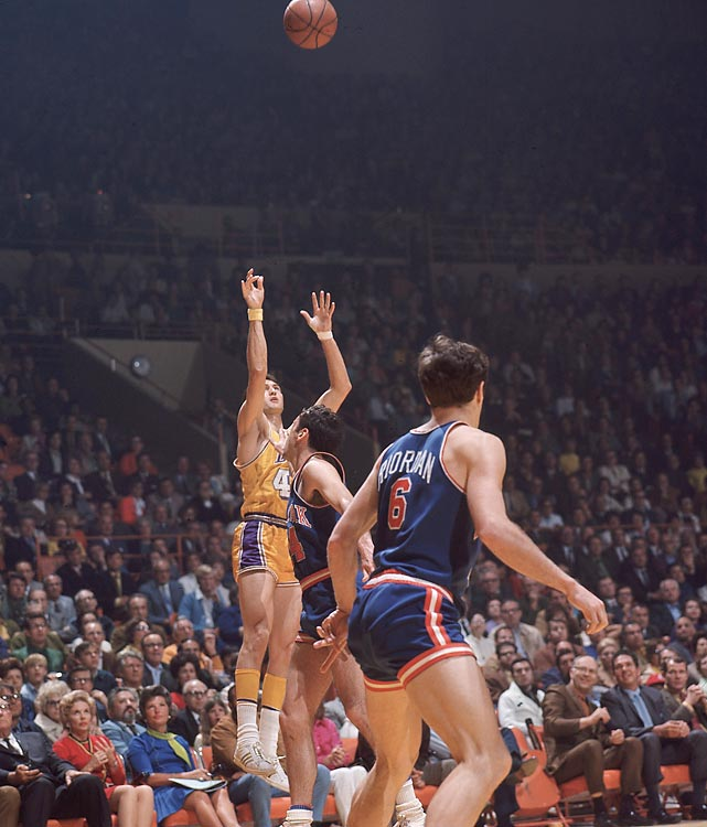 Jerry West of the Lakers launches a shot against the Knicks. West drained a dramatic, desperation 63-footer as time expired in Game 3 to send things to overtime. The Lakers went on to lose that game and dropped the series to New York, 4-3.