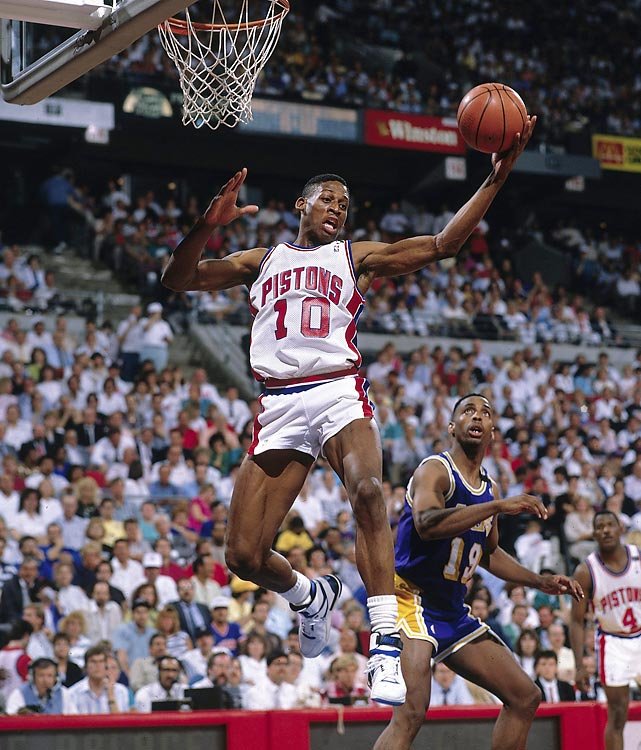 Pistons forward Dennis Rodman snatches a board against the Lakers. Detroit ended L.A.'s bid for a third straight title with a four-game sweep after Magic Johnson injured his hamstring early in Game 2.
