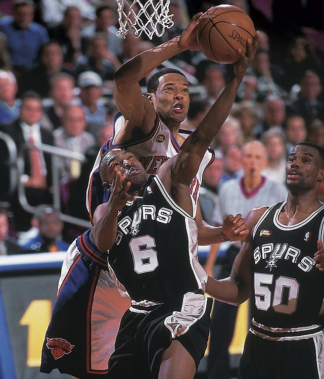 Marcus Camby of the Knicks blocks Spurs guard Avery Johnson in Game 3. Johnson would have the last laugh, hitting a last-minute shot to close out New York in Game 5.