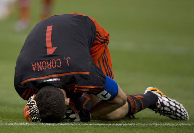Mexico goalkeeper Jesus Corona holds his head after colliding with teammate Francisco Rodriguez in Wednesday's friendly vs. Israel at Estadio Azteca.
