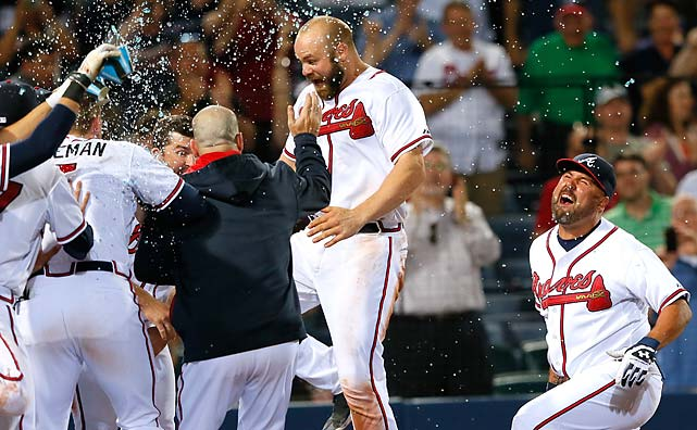 Evan Gattis celebrates with his teammates after hitting a walk-off homer in the tenth inning in an April 21 win over the Miami Marlins.