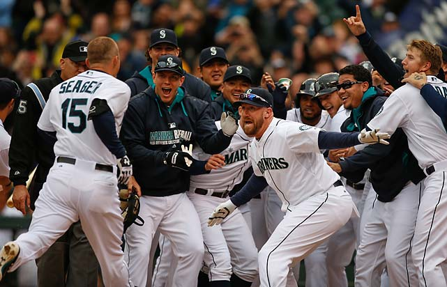 Kyle Seager is greeted by teammates after hitting the game-winning, walk-off, three-run homer to defeat the Houston Astros on April 23.