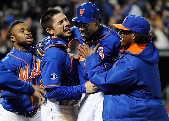 New York Mets' Eric Young Jr., Travis d'Arnaud and Jenrry Mejia rush to hug Curtis Granderson after Granderson hit a walk-off single off Miami Marlins relief pitcher Steve Cishek on April 25.