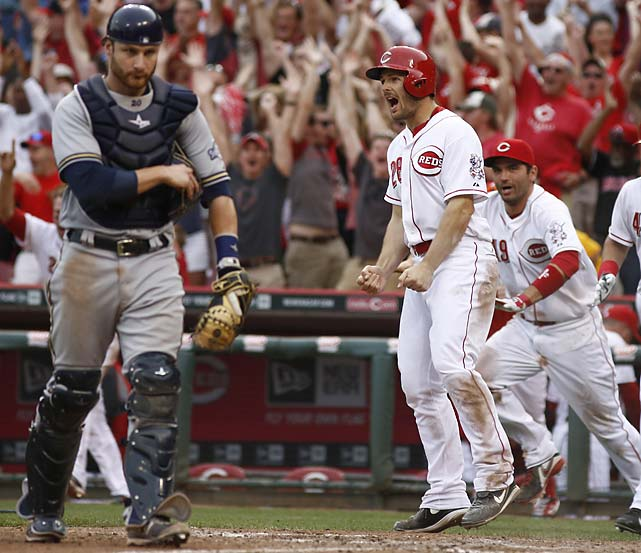 Chris Heisey reacts after scoring on a Todd Frazier double hit in the tenth inning of a May 4 game against Milwaukee.
