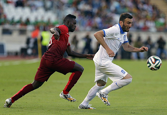 Portugal and Varela (left) drew with Greece and Vasilis Torosidis in a World Cup tune-up in Lisbon.