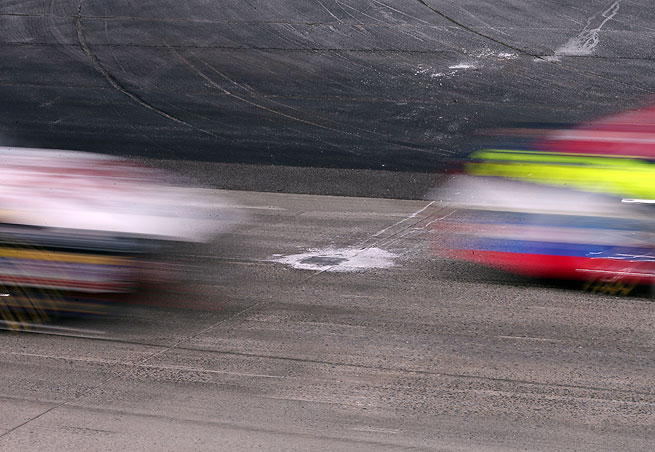 Potholes in the concete track at Dover International Speedway needed to be repaired before Sunday's NASCAR Sprint Cup race could resume.