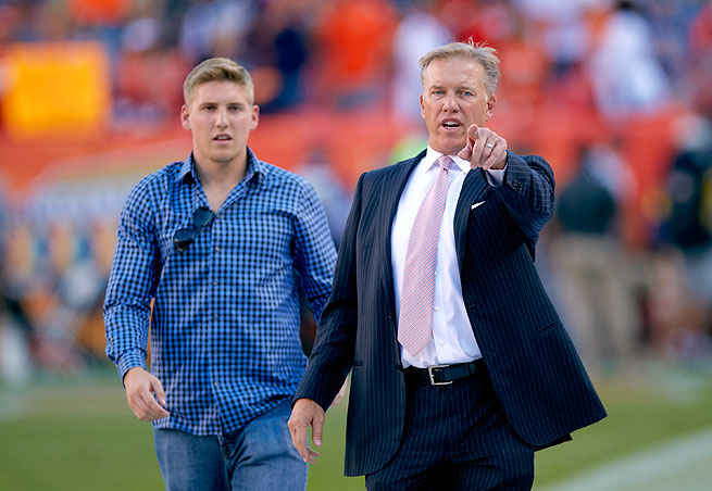 Jack Elway, left, was arrested following an incident in downtown Denver on Saturday.