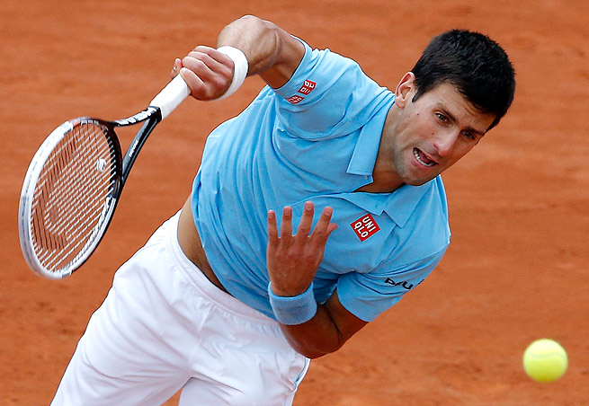 Novak Djokovic defeated Jo-Wilfried Tsonga in straight sets to reach the French Open quarterfinals.