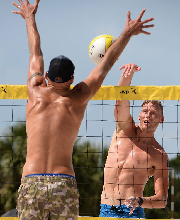Phil Dalhausser blocks a shot by Casey Patterson.