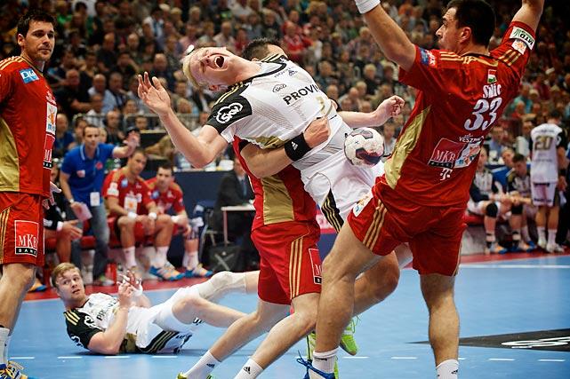 Patrick Wiencek from THW Kiel (Germany) gets fouled in EHF Champions League semifinals vs. MKB MVM Veszprem (Hungary) on May 31.