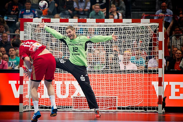 Andreas Palicka from THW Kiel takes a penalty shot from Momir Illic, MKB MVM Veszprem in EHF Champions League semifinal on May 31.