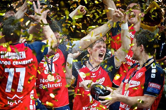 Lasse Svan (11) and teammates of SG Flensburg-Handewitt celebrate their title.